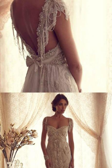 Dramatic A-Line V-Neck Cap Sleeves Beading Backless Wedding Dress with Appliques Bowknot